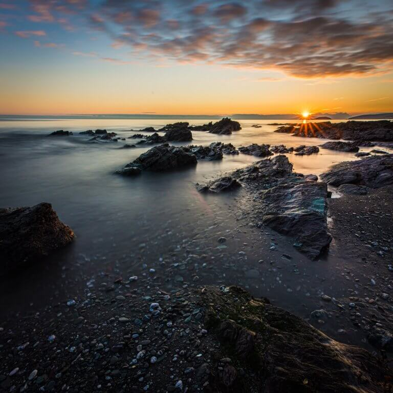 Rocks on Seaton Beach at Sunset