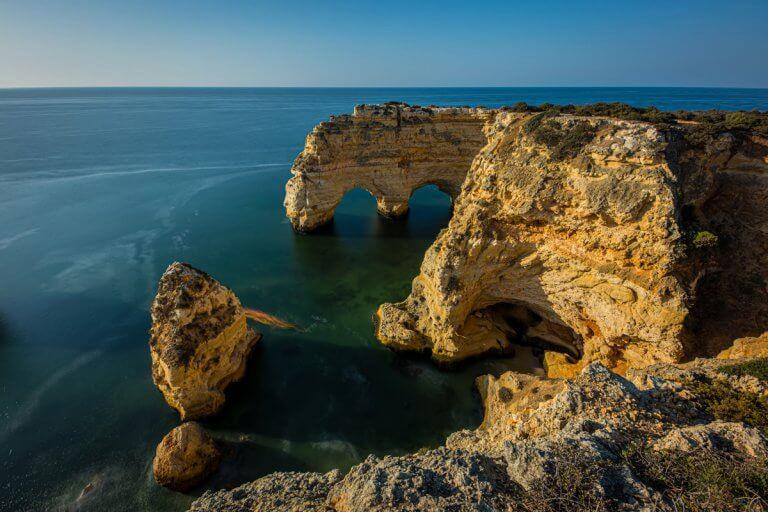Praia De Marinha Limestone Arches in Lagoa Portugal